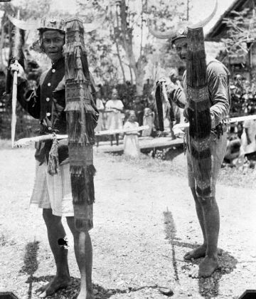 Indigenous people performing the Tjakalélé dance with spears and shields in Bora te Biromaru kampong